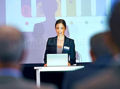 Buy stock photo Shot of a group of businesspeople watching a presentation at a conference