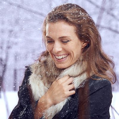Buy stock photo Shot of an attractive woman smiling in the snow