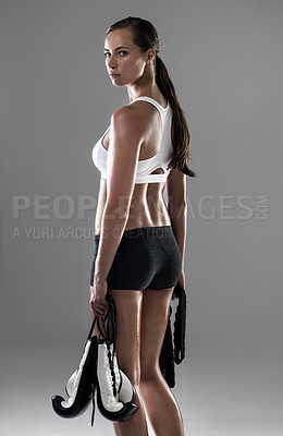 Buy stock photo Studio shot of an attractive woman ready for a boxing workout