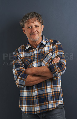 Buy stock photo A portrait of a happy mature man standing with his arms folded
