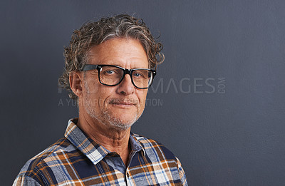 Buy stock photo A cropped portrait of a confident mature man with glasses