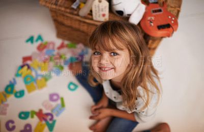 Buy stock photo Portrait of an adorable little girl playing with colorful toy letters