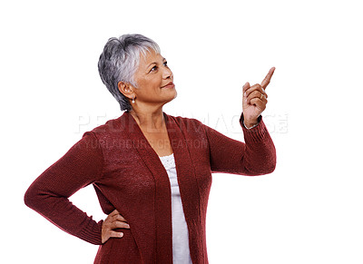 Buy stock photo Studio shot of a mature woman pointing to copyspace isolated on white
