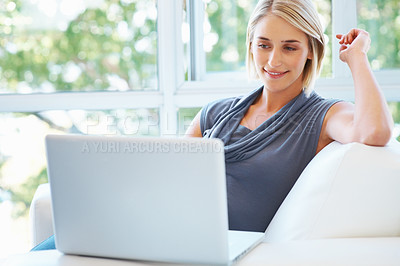 Buy stock photo View of woman smiling while working on laptop