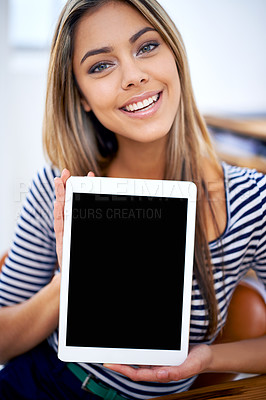 Buy stock photo A portrait of a beautiful young woman showing a tablet with a blank screen