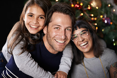 Buy stock photo Shot of a happy daughter with her parents on christmas