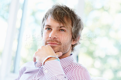 Buy stock photo Man resting chin on hand while looking off into distance