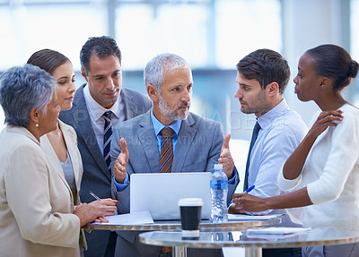 Buy stock photo A cropped shot of a group of businesspeople having a discussion at a meeting