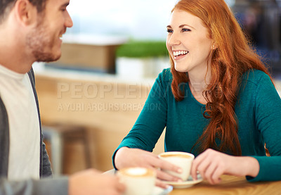 Buy stock photo A cropped shot of a young affectionate couple on a coffee date