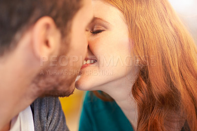 Buy stock photo Closeup shot of a young affectionate couple kissing while on a date