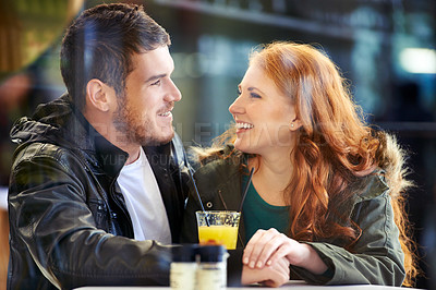 Buy stock photo Cropped shot of a happy young couple on a date at a cafe