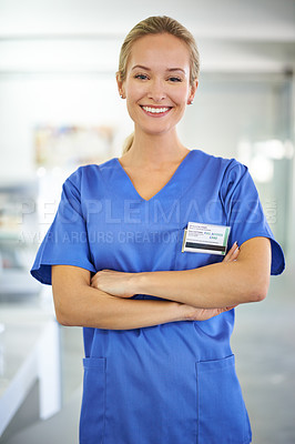 Buy stock photo Portrait of a confident young doctor wearing blue scrubs