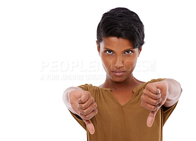 Buy stock photo Studio shot of a young woman giving thumbs down
