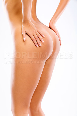 Buy stock photo Cropped shot of an attractive woman's shapely buttocks
