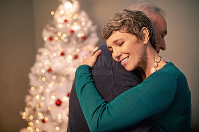 Buy stock photo Cropped shot of a happy couple embracing at Christmas