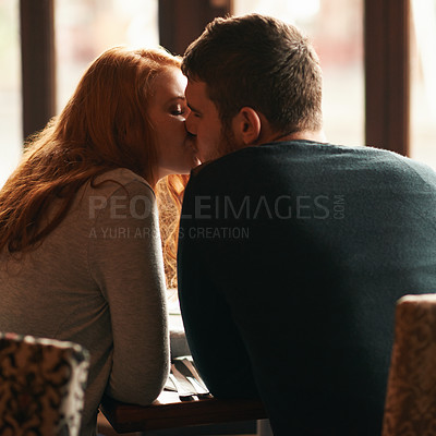 Buy stock photo Rear view shot of a loving young couple on a date