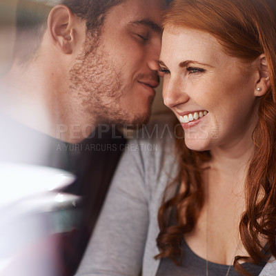 Buy stock photo Shot of an affectionate young couple on a date