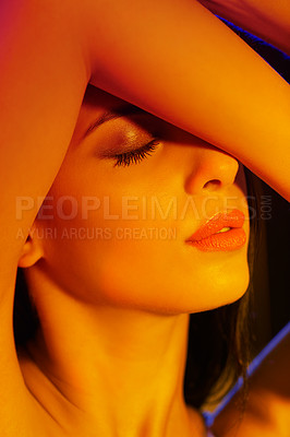 Buy stock photo A young woman with artistic lighting on her in studio