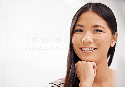 Buy stock photo An attractive young asian businesswoman looking at the camera