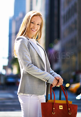 Buy stock photo A gorgeous young woman with her handbag in New York