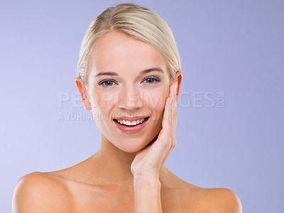 Buy stock photo A young blonde woman touching her skin against a purple background