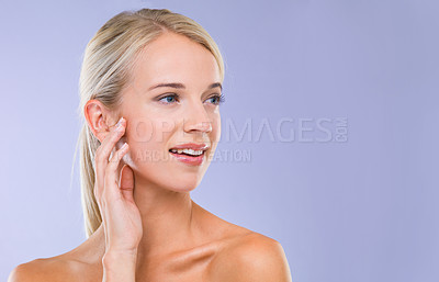 Buy stock photo A fresh-faced blonde woman looking away against a purple background
