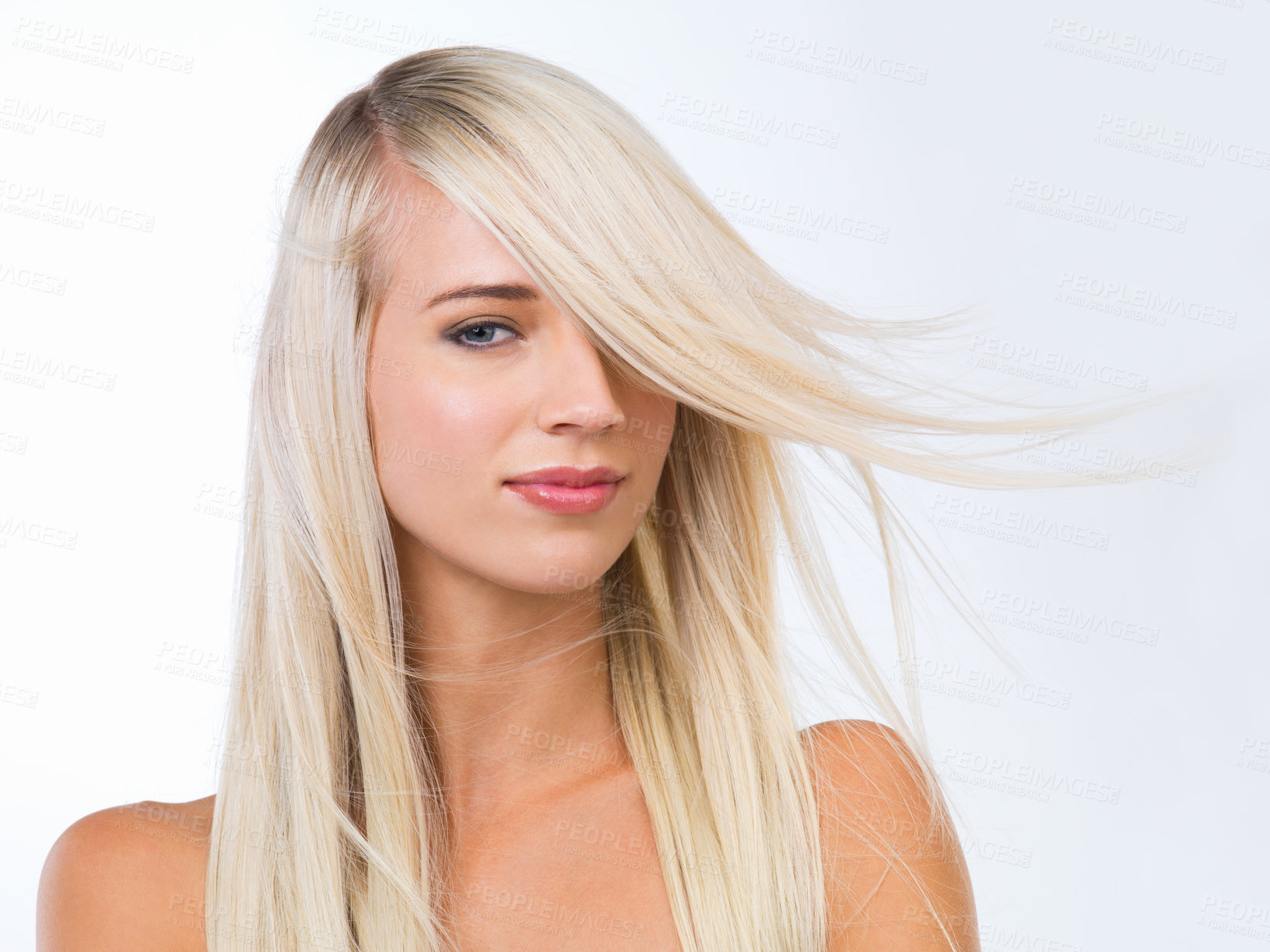 Buy stock photo Studio portrait of a gorgeous young blonde woman against a white background