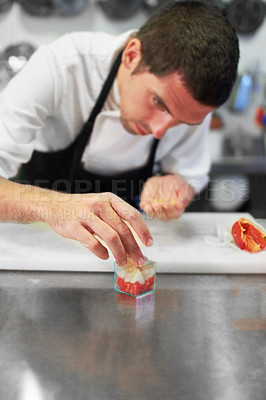 Buy stock photo A chef carefully preparing a gourmet meal