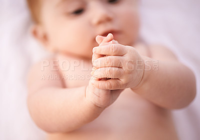 Buy stock photo A cropped shot of an adorable baby girl lying on a blanket