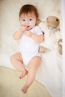Buy stock photo High angle shot of an adorable baby in a cot