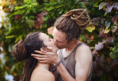 Buy stock photo A cute young couple kissing outdoors