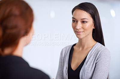Buy stock photo A cropped shot of two young professionals talking in the office