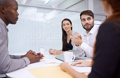 Buy stock photo Cropped shot of office workers having a meeting