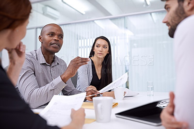 Buy stock photo A group of coworkers sitting in an office and having a meeting