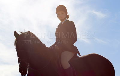 Buy stock photo Shot of a beautiful young woman riding her horse