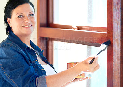 Buy stock photo Cropped shot of a woman varnishing her window frame