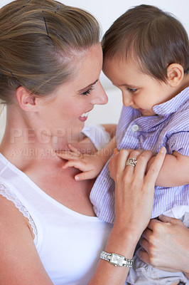 Buy stock photo A young woman with her baby