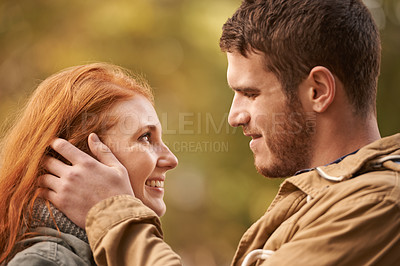 Buy stock photo Shot of a happy young couple getting lost in each other's presence