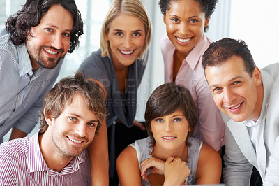 Buy stock photo Diverse business professionals at the office posing for a group shot, looking happy and confident