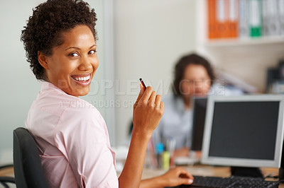 Buy stock photo Young African American business woman holding pencil and smiling at you