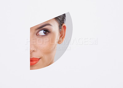 Buy stock photo Shot of a beautiful young woman through a cut out shape