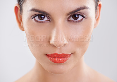 Buy stock photo Closeup shot of a beautiful young woman against a grey background