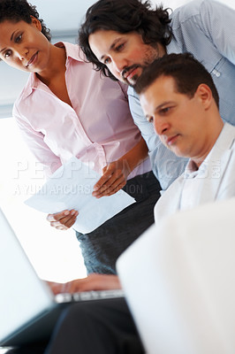 Buy stock photo Low angle view of business man working on laptop