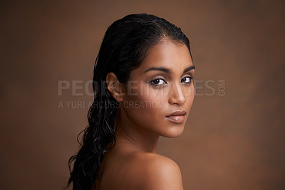 Buy stock photo Studio shot of a beautiful young woman against a brown background