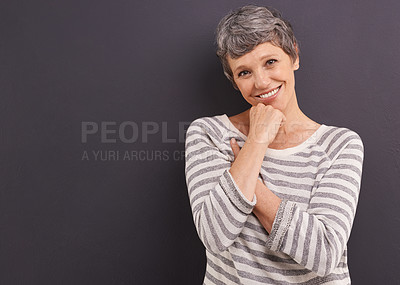 Buy stock photo Studio portrait of a happy elderly woman against a gray background