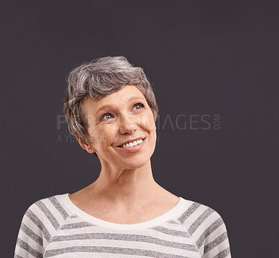 Buy stock photo Studio shot of a thoughtful elderly woman against a gray background