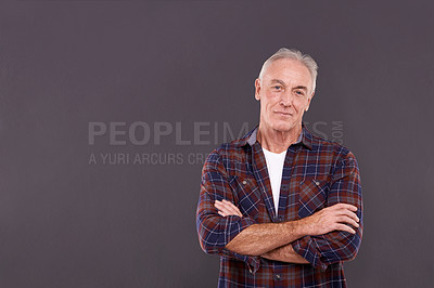 Buy stock photo Studio portrait of a confident elderly man against a gray background