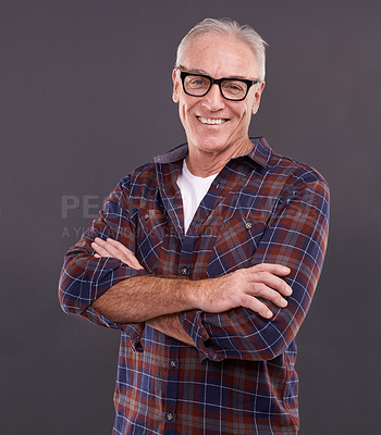 Buy stock photo Studio portrait of a confident elderly man wearing glasses against a gray background