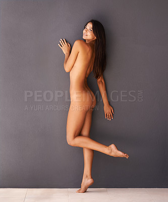 Buy stock photo A beautiful nude woman posing against a grey background