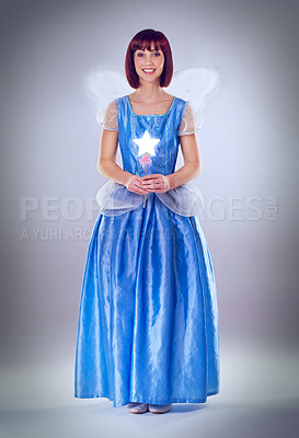 Buy stock photo A full length shot of a fairy godmother in a blue gown
